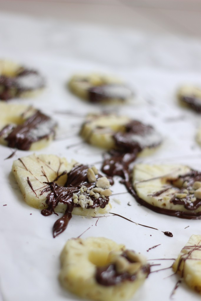 easy New Year's Eve dessert/ chocolate topped pineapple slices