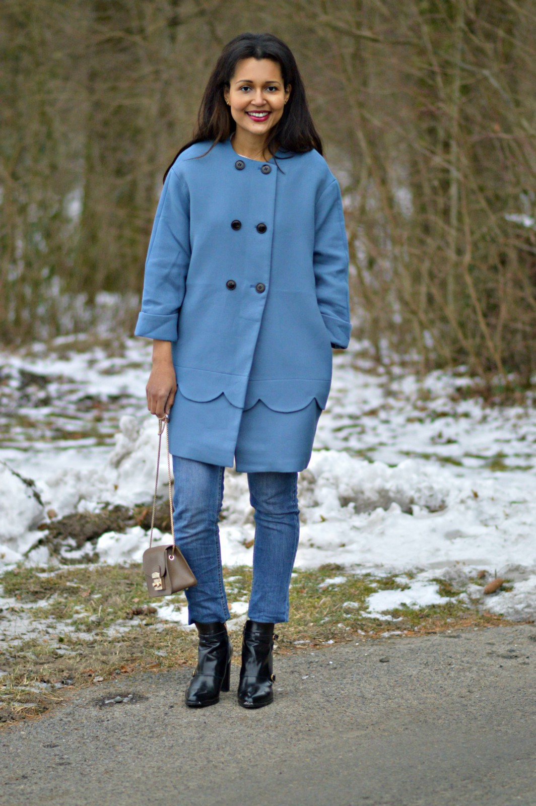 blue coat/ currently wearing