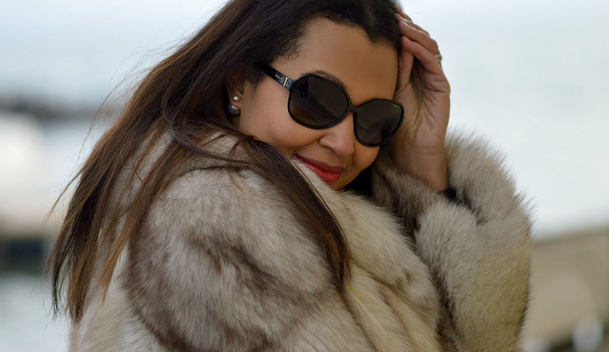 silver fox fur coat/ pearl earrings/ big sunglasses