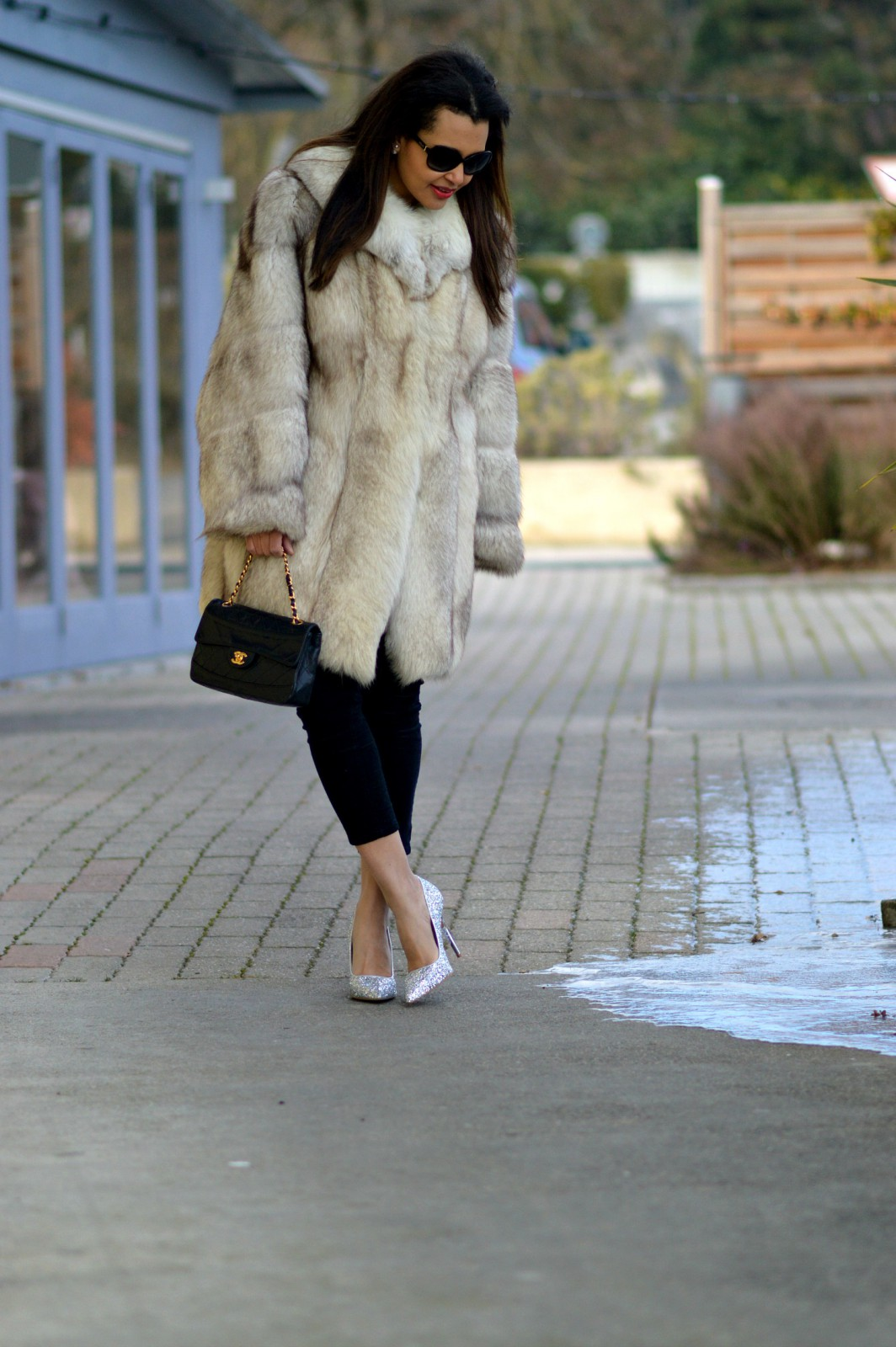 currently wearing / fur coat/ silver high heels