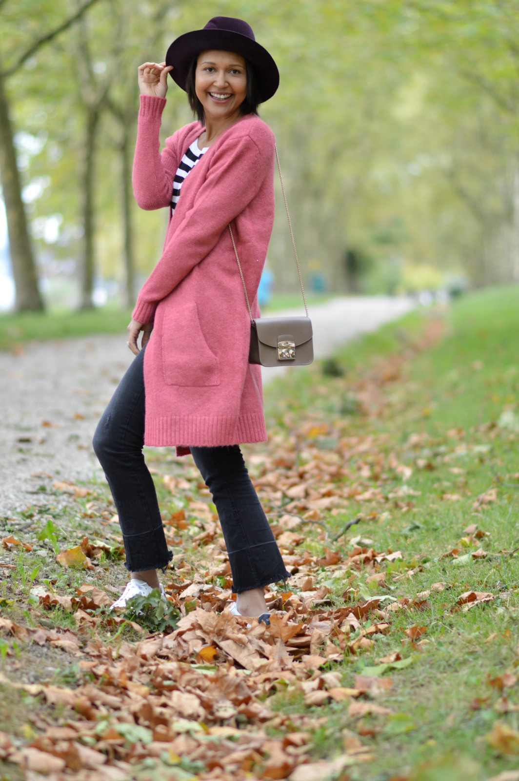 distressed hem jeans/pink cardigan/currently wearing