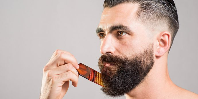 man grooming his beard